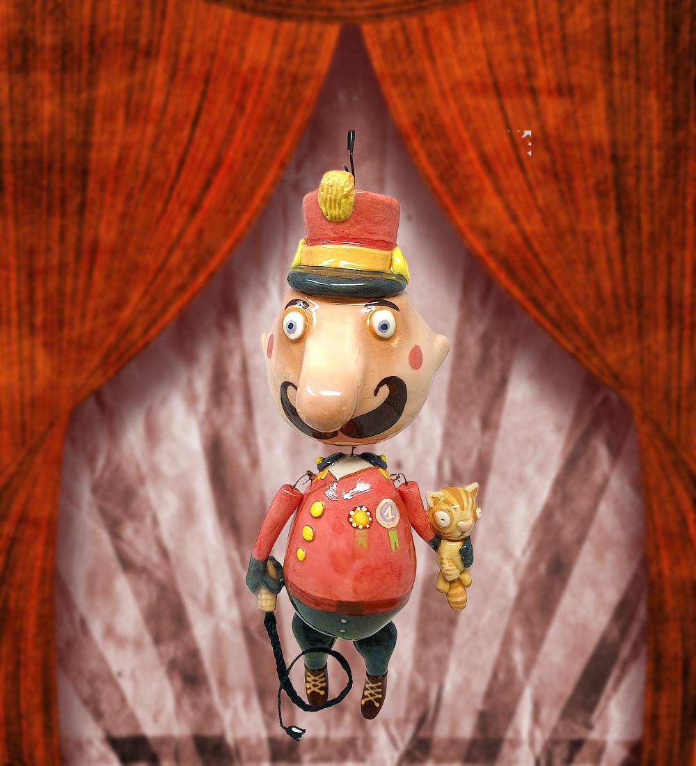 Marionette in ceramica dipinta con ingobbio